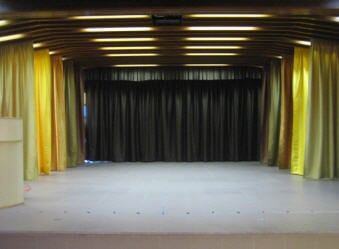 The school hall adopts five colors curtain. This can improve the spacious feeling of the place.